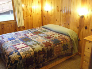 Cabin #15 has Queen beds in 3 bedrooms.  The 4th bedroom has bunk beds.  All bedrooms have dressers and closets.