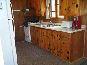 Cabin 5 Kitchen stocked with dishes, pots, pans, coffee maker, microwave & full size appliances