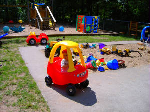 Little Tykes Large Playground.  Riding Toys for pre-school age kids.  Sand toys, slides, and swings for all ages.  Glider & lawn chairs for adult relaxation!