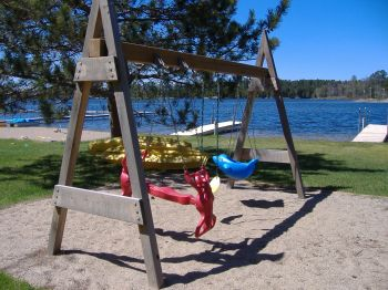 Lakeside Swings for all ages.  Infant swing, big-kid swing, and double-horse-swing!  This set is located adjacent to the Sand Castle Zone